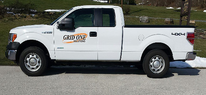 pickup truck with Grid One logo